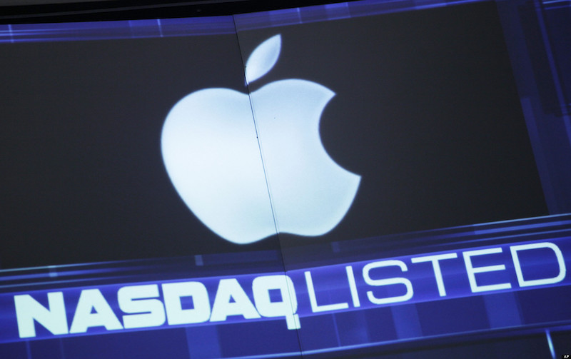 The Apple logo is shown on a stock ticker at the Nasdaq MarketSite, Tuesday, Aug. 21, 2012 in New York. Major stock indexes inched above four-year closing highs in early trading Tuesday. On Monday, Apple's surging stock propelled the company's value to $624 billion, the world's highest, ever. (AP Photo/Mark Lennihan)