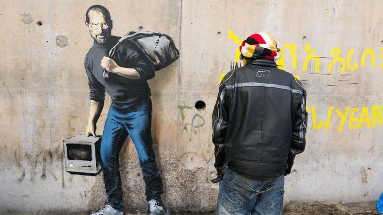 steve jobs banksy Banksy peint Steve Jobs dans le camp de réfugiés de Calais